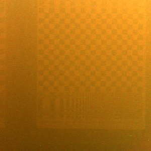 2D slice of the input light field: a tank of murky water between the camera and a checkerboard pattern. Backscatter dominates the image: the orange glow is due to the dim halogen bulb illuminating the scene.