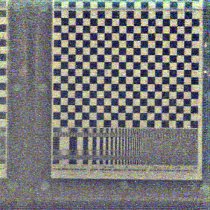 Similar to the previous hyperfan output, but with a narrower depth of field centered on the checkerboard. Here we see how depth of field is traded off for noise performance, similar to a conventional camera, except that here the in-focus elements are described by a tuneable volume instead of a plane.
