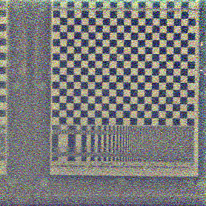 2D slice of the hyperfan-filtered scene. The depth of field of this image is wide, including most of the space between the camera and the checkerboard. The noise has been significantly attenuated, without degrading the sharpness of the checkerboard.